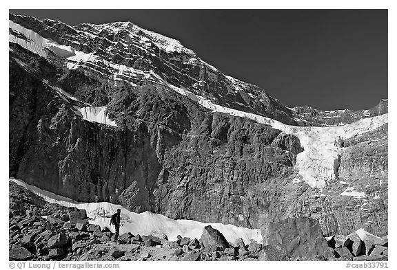 Hiker on a moraine below Mt Edith Cavell and Angel Glacier. Jasper National Park, Canadian Rockies, Alberta, Canada (black and white)