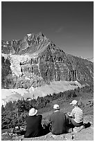 Hikers sitting in front of Mt Edith Cavell next to trail. Jasper National Park, Canadian Rockies, Alberta, Canada (black and white)