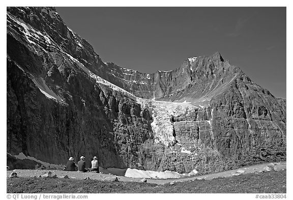 Hikers look at Angel Glacier, late morning. Jasper National Park, Canadian Rockies, Alberta, Canada (black and white)