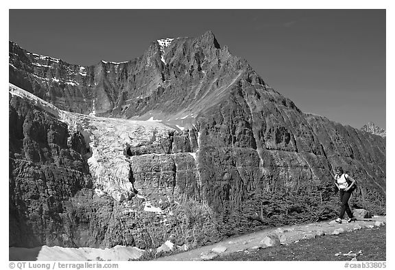 Woman hiking on trail near Mt Edith Cavell. Jasper National Park, Canadian Rockies, Alberta, Canada (black and white)