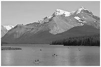 Canoes on Maligne Lake, afternoon. Jasper National Park, Canadian Rockies, Alberta, Canada (black and white)