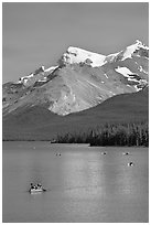 Red canoe on Maligne Lake, afternoon. Jasper National Park, Canadian Rockies, Alberta, Canada ( black and white)