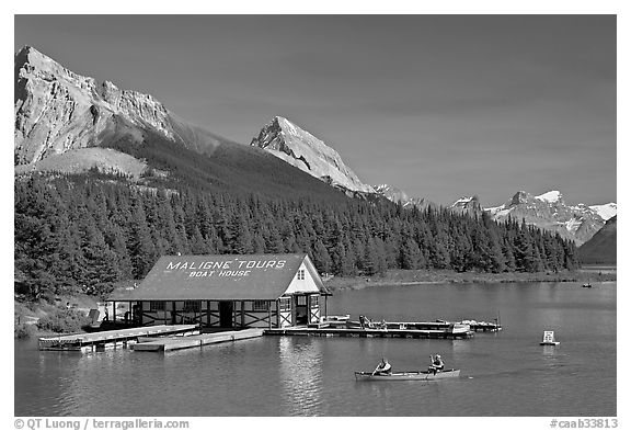 Boat house and canoe beneath Leh and Samson Peaks,  Maligne Lake. Jasper National Park, Canadian Rockies, Alberta, Canada