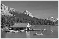 Boat house and canoe beneath Leh and Samson Peaks,  Maligne Lake. Jasper National Park, Canadian Rockies, Alberta, Canada (black and white)