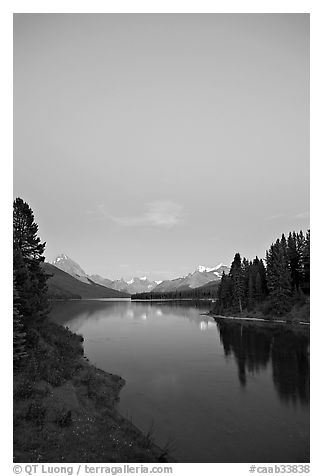 Maligne Lake from the outlet of the Maligne River, blue dusk. Jasper National Park, Canadian Rockies, Alberta, Canada (black and white)