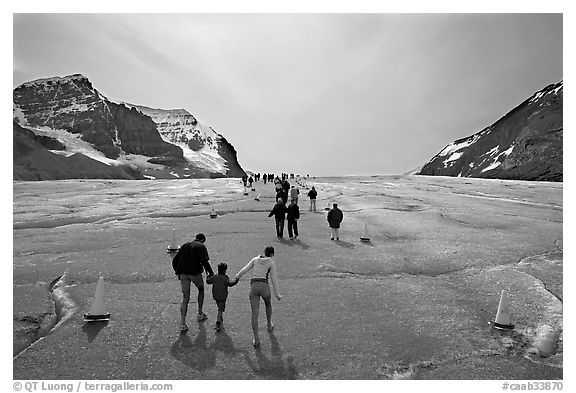 Tourists on Athabasca Glacier, Columbia Icefield. Jasper National Park, Canadian Rockies, Alberta, Canada (black and white)
