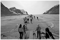 Visitors walking onto  Athabasca Glacier. Jasper National Park, Canadian Rockies, Alberta, Canada (black and white)