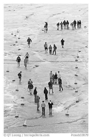 People in delimited area, Athabasca Glacier. Jasper National Park, Canadian Rockies, Alberta, Canada (black and white)