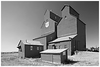 Red wooden grain elevator building. Alberta, Canada ( black and white)