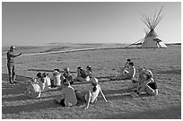 First nations man giving a lecture to students, Head-Smashed-In Buffalo Jump. Alberta, Canada (black and white)