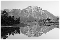 Vimy Peak reflected in Middle Waterton Lake, sunrise. Waterton Lakes National Park, Alberta, Canada (black and white)