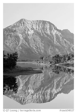 Mountain and reflection in Middle Waterton Lake, sunrise. Waterton Lakes National Park, Alberta, Canada (black and white)