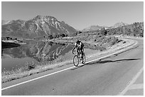 Cyclist next to Lower Waterton Lake. Waterton Lakes National Park, Alberta, Canada (black and white)