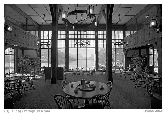 Table with view in lobby of Prince of Wales hotel. Waterton Lakes National Park, Alberta, Canada (black and white)