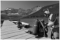 Scuba divers preparing to dive into cold waters of Cameron Lake. Waterton Lakes National Park, Alberta, Canada (black and white)
