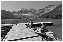 Canoists parking to dock, Cameron Lake. Waterton Lakes National Park, Alberta, Canada (black and white)