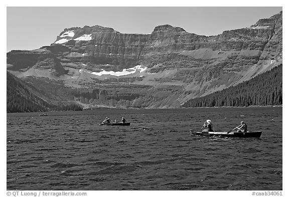 Canoists on Cameron Lake. Waterton Lakes National Park, Alberta, Canada (black and white)
