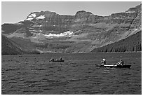 Canoists on Cameron Lake. Waterton Lakes National Park, Alberta, Canada ( black and white)