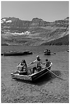 Families boating in Cameron Lake. Waterton Lakes National Park, Alberta, Canada ( black and white)