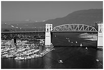 Burrard Bridge and mountains. Vancouver, British Columbia, Canada ( black and white)