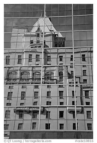 Buildings reflected in the glass windows of a high-rise buildings. Vancouver, British Columbia, Canada (black and white)