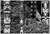 Totem collection, near the Capilano suspension bridge. Vancouver, British Columbia, Canada (black and white)