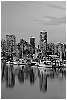 Small boat harbor and skyline at dusk. Vancouver, British Columbia, Canada ( black and white)