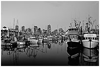 Fishing boats and skyline at dusk. Vancouver, British Columbia, Canada (black and white)