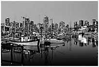Fishing boats and skyline at night. Vancouver, British Columbia, Canada ( black and white)
