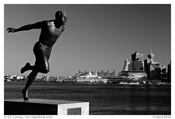 Runner's statue and Harbor center, late afernoon. Vancouver, British Columbia, Canada (black and white)