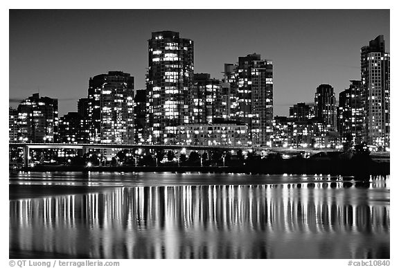 Black and white picture photo high rise buildings reflected in false creek at night vancouver british columbia canada