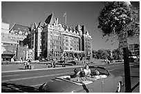 Red convertible car and Empress hotel. Victoria, British Columbia, Canada ( black and white)