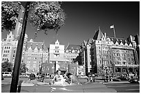 Red convertible car and Empress hotel. Victoria, British Columbia, Canada (black and white)
