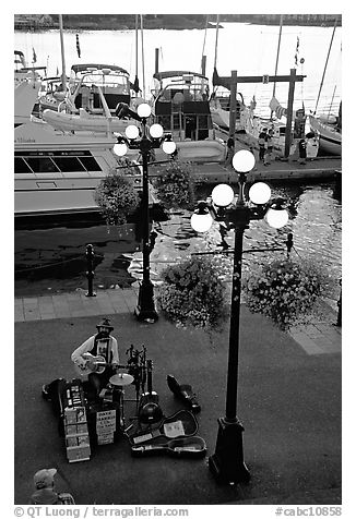 Street performers on the quay of Inner Harbor. Victoria, British Columbia, Canada (black and white)