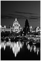 Parliament buildings lights reflected in the harbor. Victoria, British Columbia, Canada (black and white)