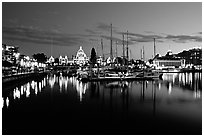 Boats in inner harbour and parliament buildings lights. Victoria, British Columbia, Canada (black and white)