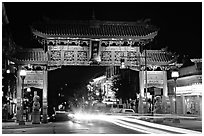 Chinatown gate with trail of lights at night. Victoria, British Columbia, Canada (black and white)
