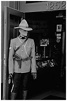 Mannequin representing a Canadian police at the entrance of a store. Victoria, British Columbia, Canada ( black and white)