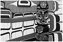 Totem and motif painted on the wall of carving studio. Victoria, British Columbia, Canada (black and white)