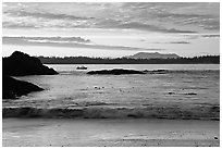 Marine landscape with a small boat in a distance, sunset. Pacific Rim National Park, Vancouver Island, British Columbia, Canada ( black and white)