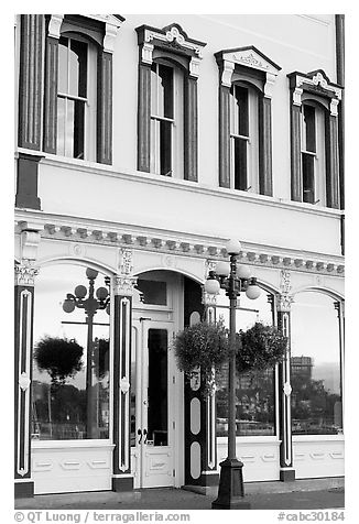 Store with reflections in windows. Victoria, British Columbia, Canada (black and white)