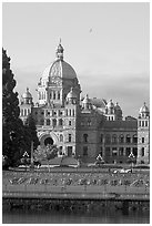 Legistlative buildings and Victoria written in flowers, morning. Victoria, British Columbia, Canada (black and white)