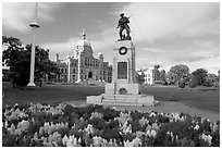 Flowers, memorial, and parliament building. Victoria, British Columbia, Canada (black and white)