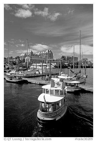 Harbor Ferry with Canadian flag. Victoria, British Columbia, Canada (black and white)
