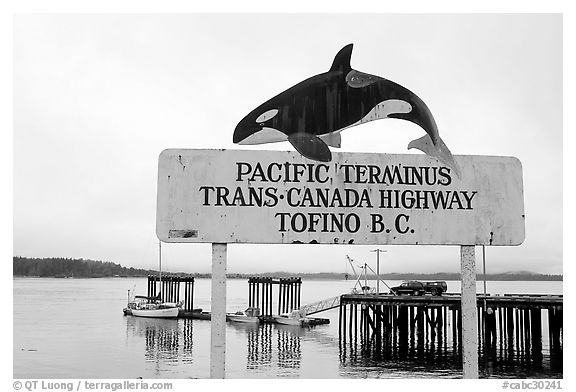 Sign marking the Pacific terminus of the trans-Canada highway, Tofino. Vancouver Island, British Columbia, Canada (black and white)