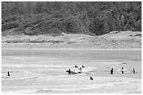 Surfers in Long Beach, the best surfing spot on Canada's west coast. Pacific Rim National Park, Vancouver Island, British Columbia, Canada ( black and white)