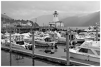 Yachts, harbour and lighthouse, Port Alberni. Vancouver Island, British Columbia, Canada ( black and white)