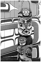 Totem pole and wall of Carving studio. Victoria, British Columbia, Canada ( black and white)