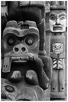 Totem poles in Thunderbird Park. Victoria, British Columbia, Canada (black and white)