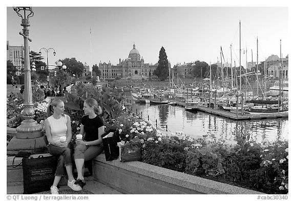 Young Women sitting, Inner harbor. Victoria, British Columbia, Canada (black and white)